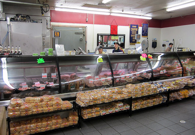 retail meat cooler and display case at Duma Meats